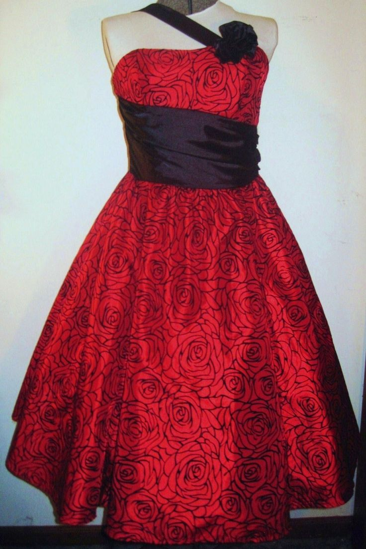 Refashioned/Reloved dress with pinnable flower.  Main dress is iridescent red taffeta with black velvet floral flocking.  Strap, midriff and flower are black satin.