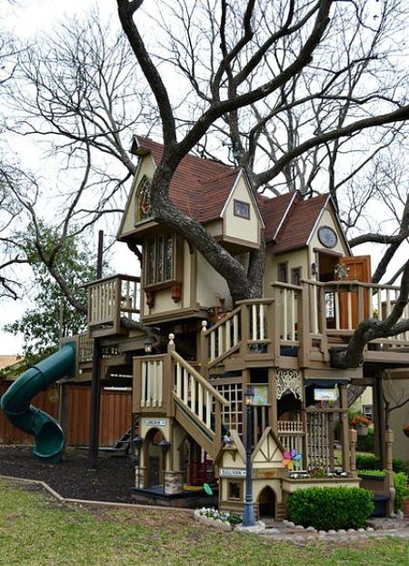 The ultimate tree house for kids equipped with a climbing wall, rope ladder, suspension bridge and zip line! wow
