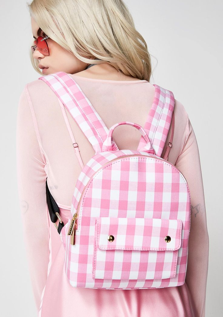 Skinnydip Gingham Backpack got ya lookin' so cute! This adorable backpack has a pink N' white plaid print, a zipper top closure, and a lil pocket on the front.