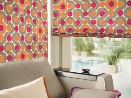 Outdoor fabric is perfect for Roman shades on a porch.