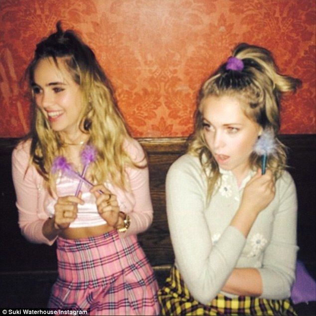 Whatever! Suki showed off her model frame in a high waisted pink plaid mini skirt, crop to...