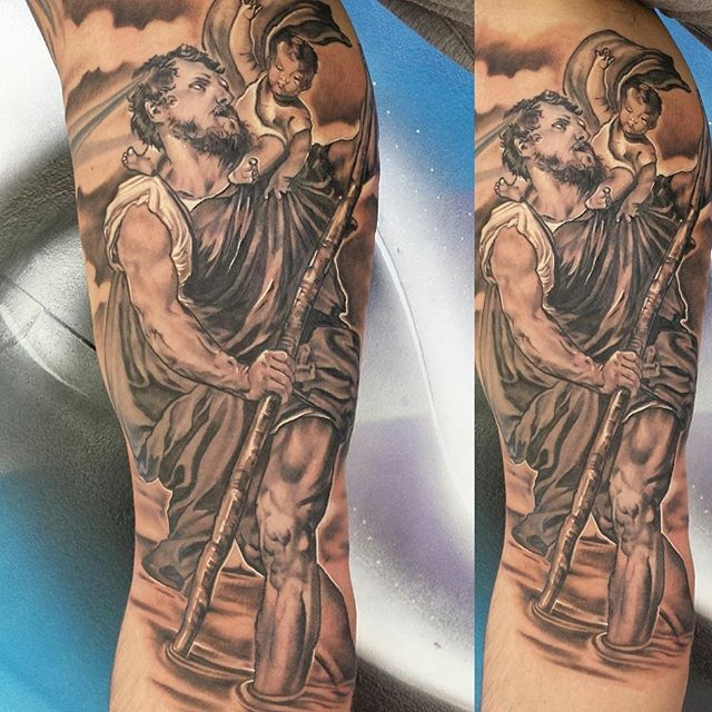 St. Christopher portrait tattoo by the one and only Sam. Incredible work and detail  Find us on Facebook for more of our work, upcoming events and a special something this weekend  __________________________________________ #BelfastTattooCollective #belfast #potrait #ohmygod #stchristopher #bng #bngtattoo #blackngrey #blackandgreytattoo #blacknwhite_perfection #blacktattoo #greyscale #saint #sainttattoo #sleeve #sleevetattoo #kurosumi #supportgoodtattoos #tattooarmada