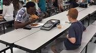 FSU football player joins boy with autism eating alone