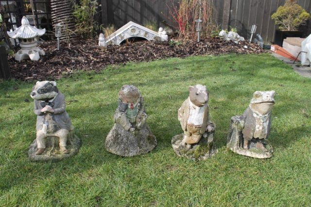 4 Very old stone ( concrete ) Wind in the willows figures in a very weathered condition but still ha