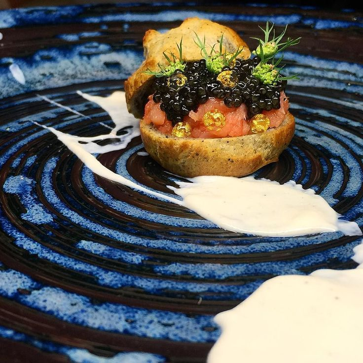 Smoked salmon caviar kuro goma-pate a choux and yuzu creme.  by chefjohn