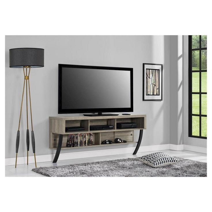 """Perfect for small spaces, the Ameriwood Home Asher Wall Mounted TV Stand for TVs up to 65"""" provides you with storage and organization. This Wall Mounted TV Stand can accommodate a flat panel TV up to 65."""" The modern floating design features 5 open shelves for your cable box, DVD player, gaming systems and for storing DVDs, books and other media. The wire management holes prevent your cords from becoming an eyesore, while sliding back panels give you easy access to outlets and p..."""