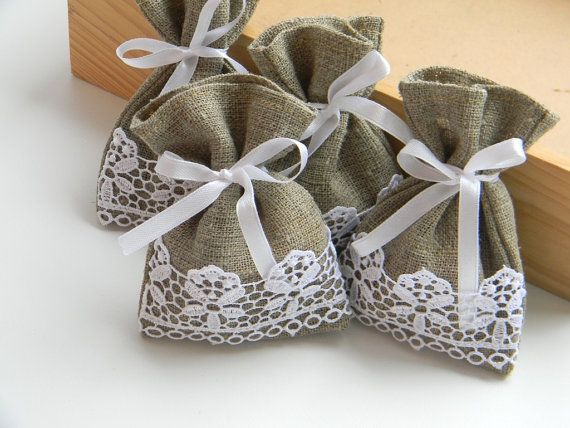 Wedding favor bags...burlap with lace -- tie with gold bows and put lavender inside as potpourri!