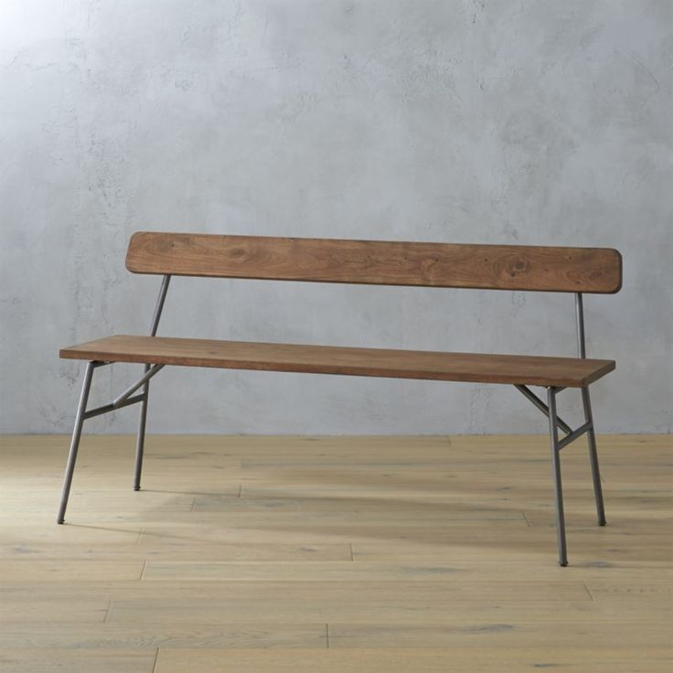 modern scholar.  A study in the discipline of design, mixed media bench waxes schoolhouse nostalgic.  Seat and back span slim and simple, crafted of acacia wood stained a light matte brown to expose the character of the wood's natural knots, cracks and splits.  Straightforward silhouette angles slightly back on steel frame that extends up the back with exposed hardware and a raw patina that deepens over time.