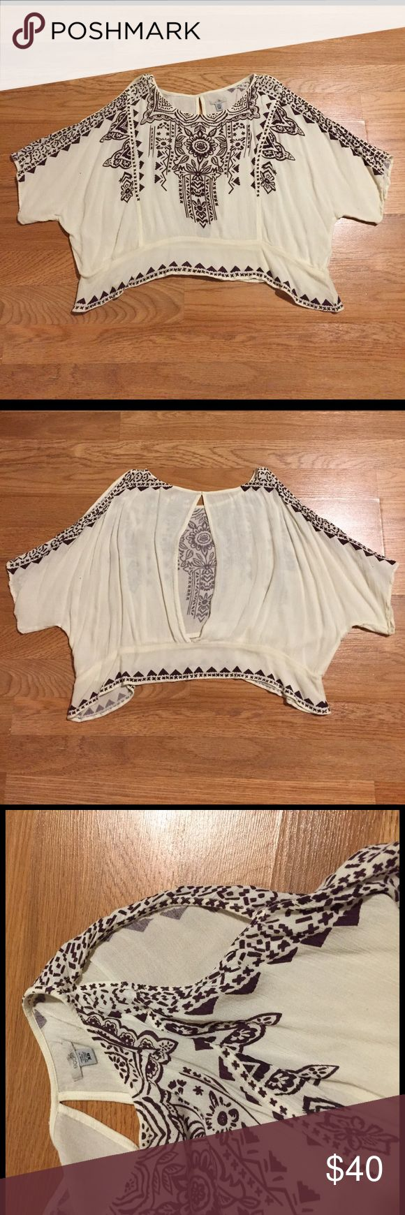 Open shoulder crop top festival blouse Artsy top from Ecoté at Urban Outiftters. Cropped and also open shoulder, with a slightly open back. Design is a dark purple. Can model if needed. Open to offers. Just want to get rid of stuff **not free people Free People Tops Blouses