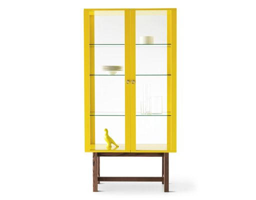 Home storage, a yellow glass-door cabinet