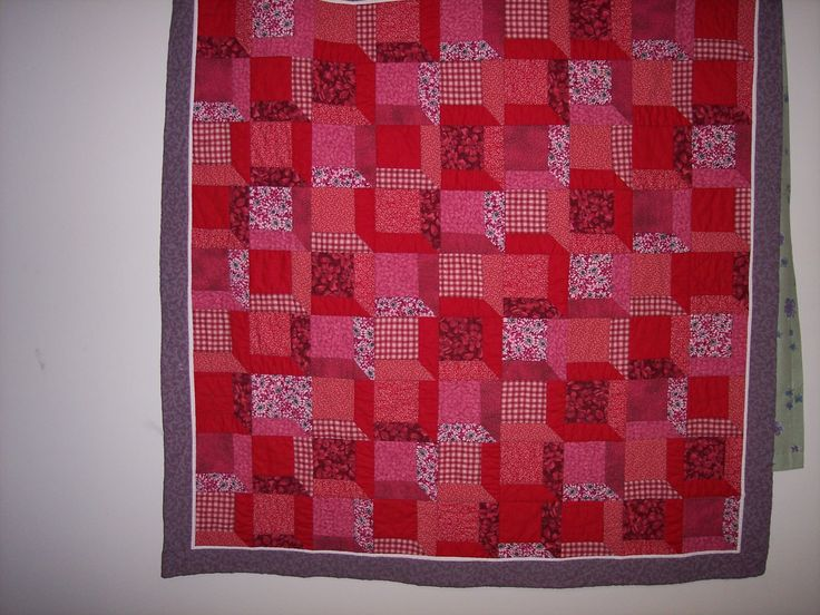 I started this tumbling block quilt after a particularly difficult February.  I wanted to some bright reds to brighten the dark winter nights and decided to experiment with quilting to embellish.