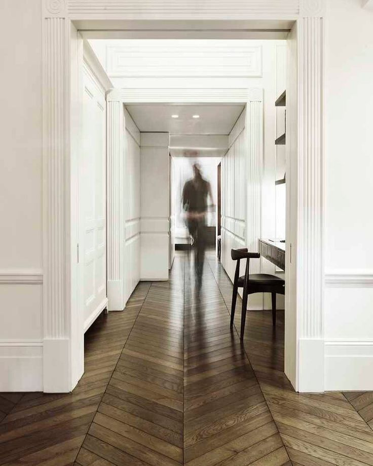 And suddenly I want herringbone patterns all over my floors. I've seen a few houses lately where this has been done so well.