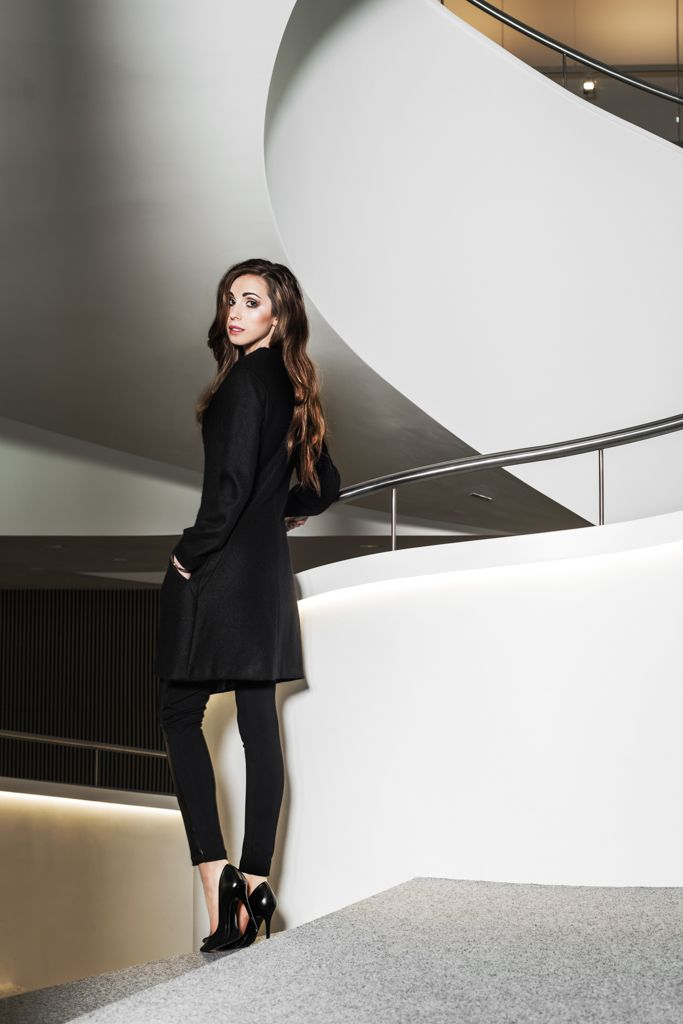 Woolen coat with leather triangle