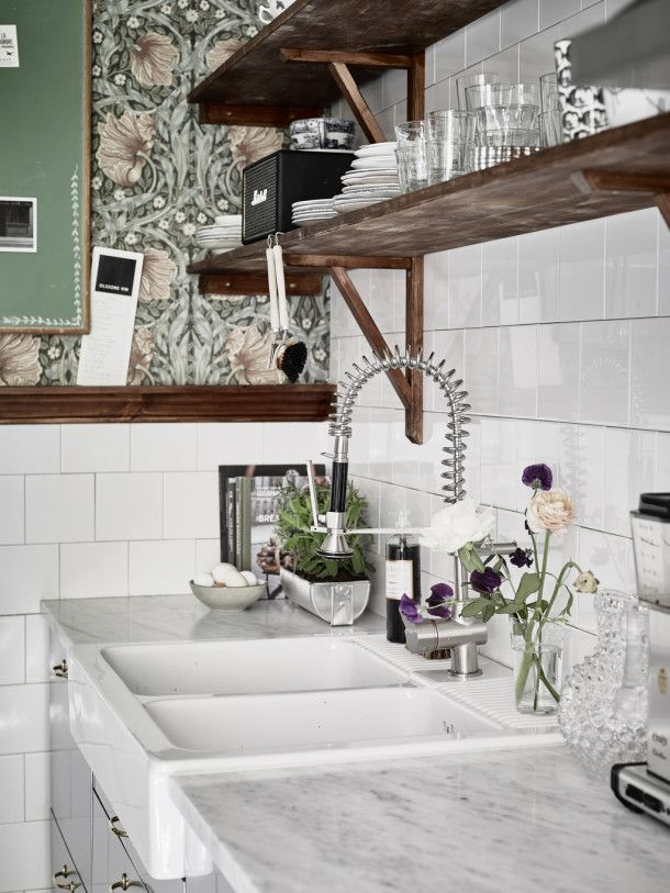 White marble Scandinavian Kitchen . Open shelves . Not crazy about the Floral wallpaper - Earnest Home co.