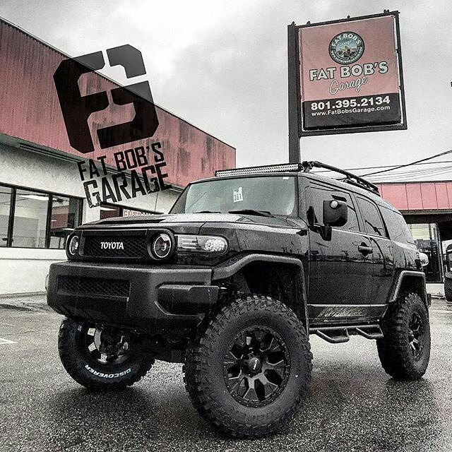 "#Repost @fat_bobs_garage  2014 #toyota #fjcruiser 6"" #procomp lift kit with 18"" #helo #he878 wheels on 35"" #coopersttpro tires #nfab side steps and a 40"" #auroraled light bar #liftedfj #liftedtoyota #blackfj #fatbobsgarage"