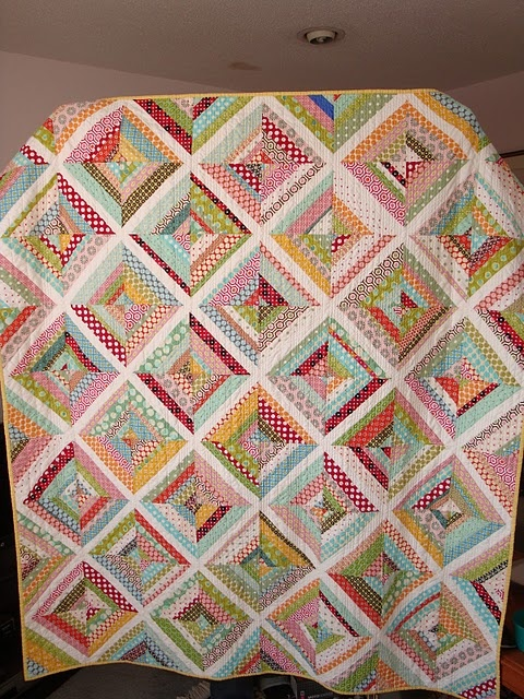 i just love string blocks, but the polka dots and quilting on this one are sooooo cool!
