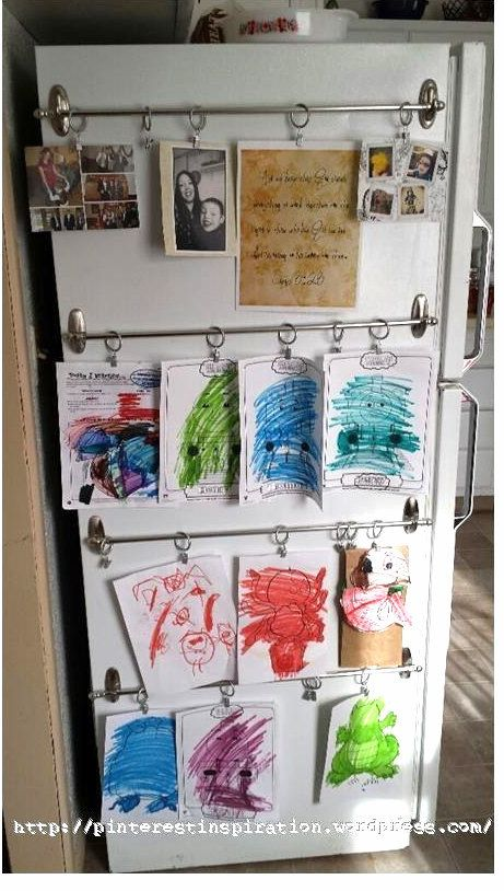 Add some shower curtain rings and rods to the side of your fridge for an easy-to-customize kids art gallery. | Here's How To Organize Literally Everything With Command Hooks