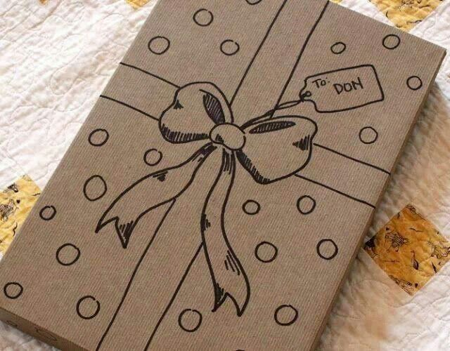 Wrap presents in brown paper and draw on bows and decorations. It also functions as a gift tag! Just make sure the marker doesn't go through to the gift.