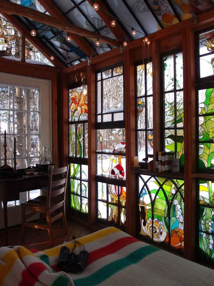 Three years ago, stained glass artist and jewelry makerNeile Cooperwas realizing that her success in jewelry making was leaving her missing the depth of work that her first love of stained glass commissions had brought her. Missing her original trade of creating beautifully detailed stained glass panels — combined with a passion for cabins and small living — Neile and her partner, Robert Giaquinta (a private tutor), decided to add a stained glass cabin to the one-and-a-half acre property…