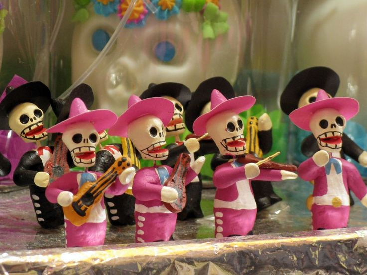 Sweets, such as pan de muertos (bread of the dead) and these spun-sugar mariachi musicians, are common treats for Dia de los Muertos. The sweet candy is a balance to the bitterness of death.