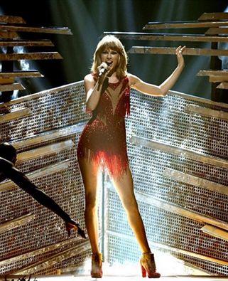 Taylor Swift wearing custom STUART WEITZMAN