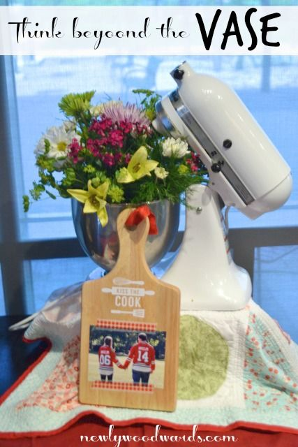 Think beyond the vase: Use a KitchenAid mixer to hold that gorgeous floral arrangement for a kitchen bridal shower.