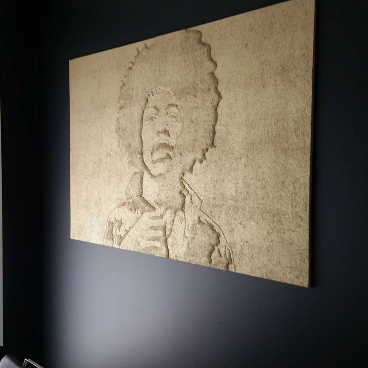 Jimi Henrix´s portrait pressed on Konto acoustic panel. Gold paint for memory of the golden ages of rock ´n roll.
