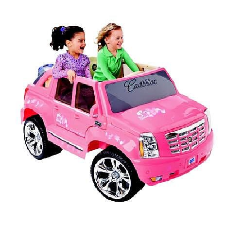 Toys R Us Exclusive Power Wheels Fisher-Price Barbie Pink Escalade is a two-seat vehicle with two working doors and all the styling of the Escalade EXT. The new styling includes a new front end re-styling to match the new Escalade and new chrome look headlight buckets which closely replicate the actual vehicle. This is a 12 volt vehicle with grass performance with a max speed of 5 mph. 4 C battery is required and included. The Power Wheels Fisher-Price Barbie Pink Escalade is a Toys R Us…