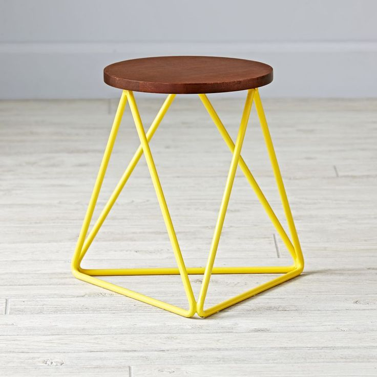 Shop Eric Trine Linear Yellow Stool.  This modern stool is definitely top of the line.  Designed exclusively by Eric Trine, the linear design gives it a sleek, modern look that pairs perfectly with any décor.