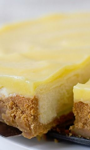 Lemon Cheesecake Recipe ~ Creamy and rich, this Lemon Cheesecake has a cookie crust and is topped with a tart lemon curd.