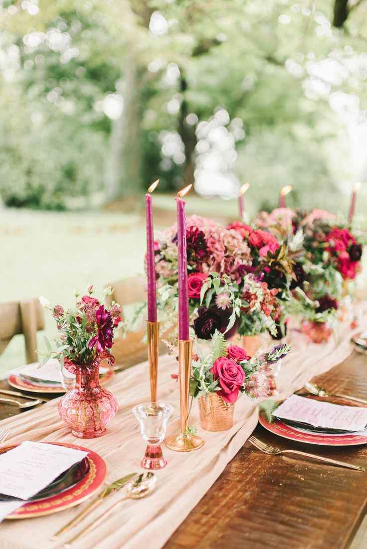 A dreamy blush runner brought color and softness to the table while keeping the dark wood exposed. We also love the midcentury candle holders that gave this table setting extra metallic details | FallBook 2015 {Elizabeth Fogarty}