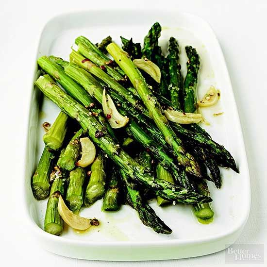 Yum! Serve this nutritious (and simple) garlic-roasted asparagus recipe with a classic steak and mashed potatoes dinner. Sprinkle Parmesan over these delicious greens for extra flavor.