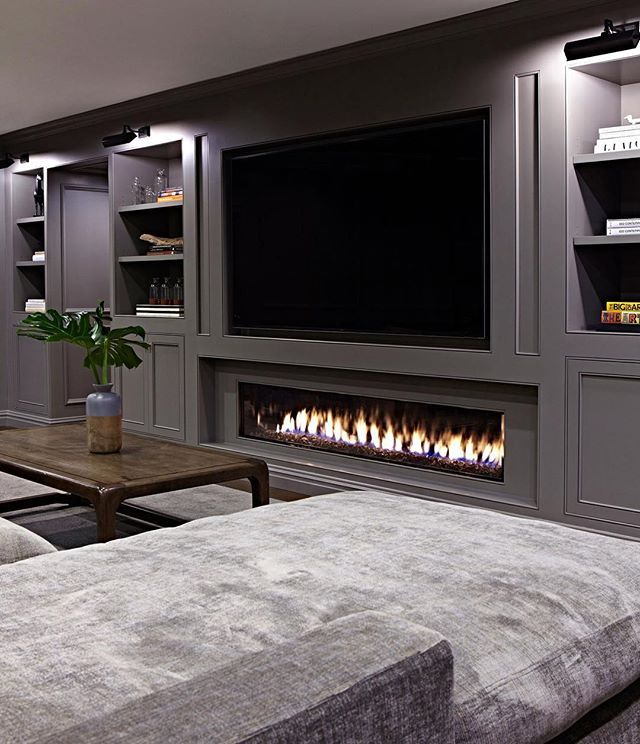 """Not everyday one gets to put in a fireplace longer than most humans in a basement. And definitely not everyday a room is long enough to accommodate a 20' long sofa. I'm just happy we can count on fabricators who look at a crazy drawing and generally say """"no problem""""."""