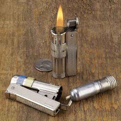Imco lighter.  Windproof, wick & reservoir pull out to act as a candle, and cheaper than a Zippo.