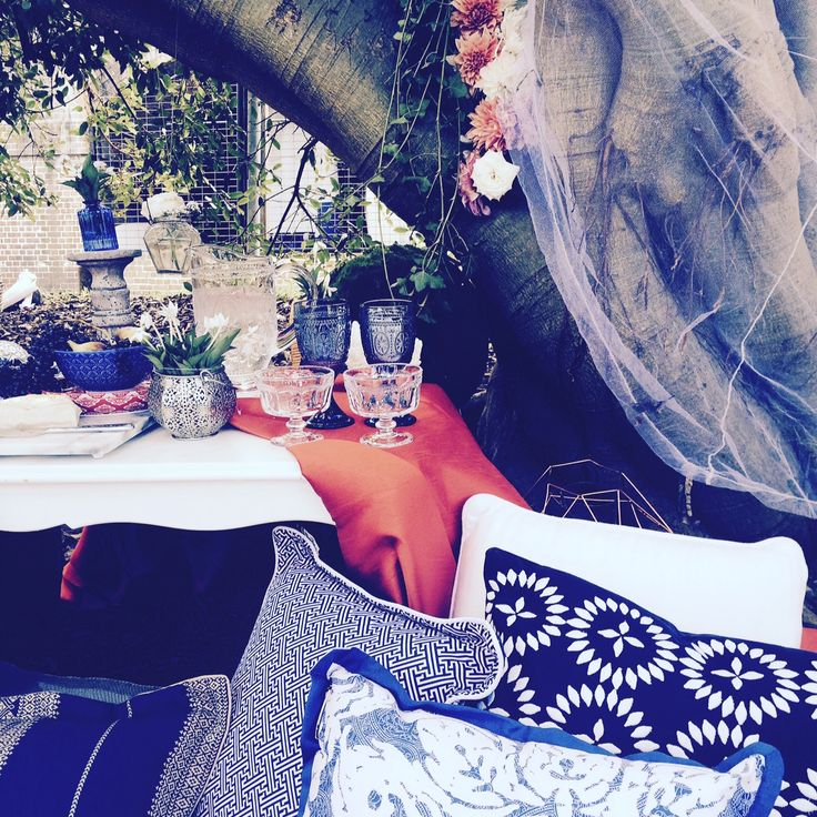 Dahlias nestled in the arms of the Moreton Bay Fig Mounds of cushions Silk Table Cloth Coloured Drinking Vessels