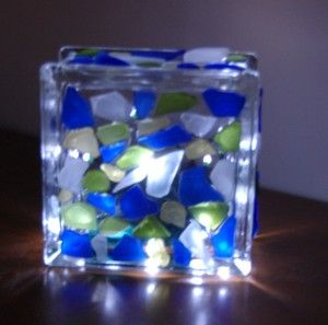 Beach sea glass mosaic block light. So pretty at night outside in the garden or on the deck/patio. DIY tutorial on how to make it from Coffee Break with Liz & Kate.