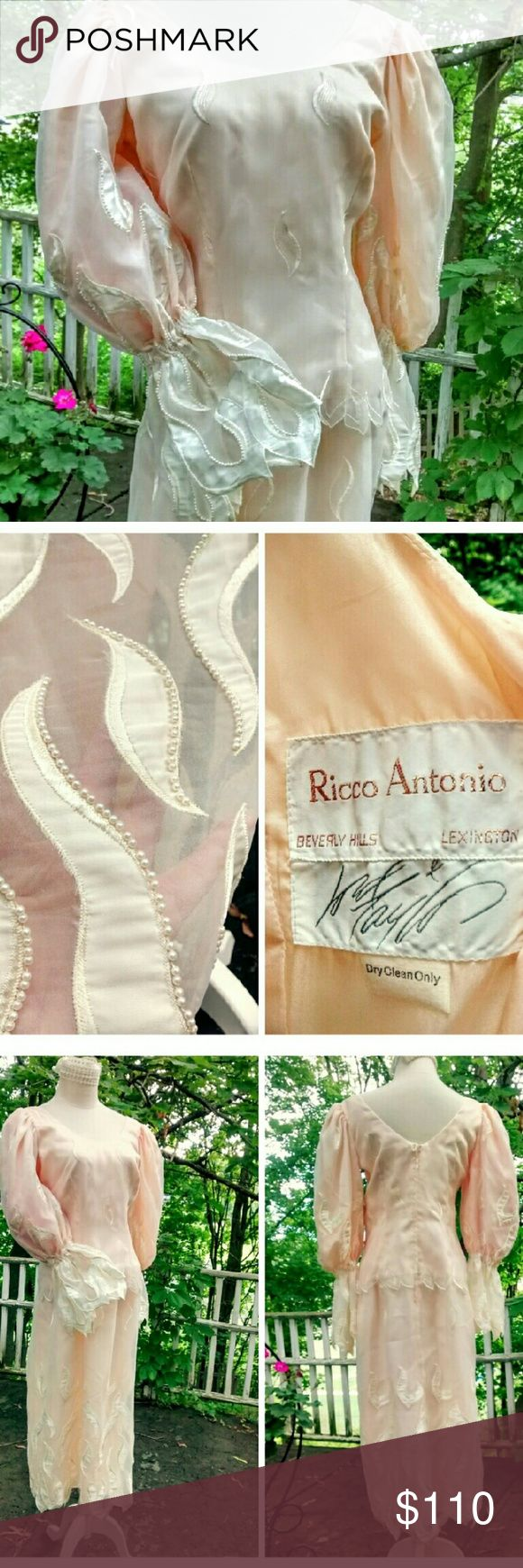 Vintage Ricco Antonio Beverly Hills Couture Dress Most romantic sleeves, executed perfectly in silk, satin and pearls..puffed upper sleeves end below elbows + then flare out to outrageous sheer cuffs.. dress is fully lined. 1990's purchase from Lord + Taylor. NEVER WORN!! No browning or other age/vintage issues. Rear metal zipper. Hand applied pearled design is on front + back of dress. Dropped waist w/scallop detail. mannequin is size 6-8 + it's way too big. This dress is an 10-12. Perfect…