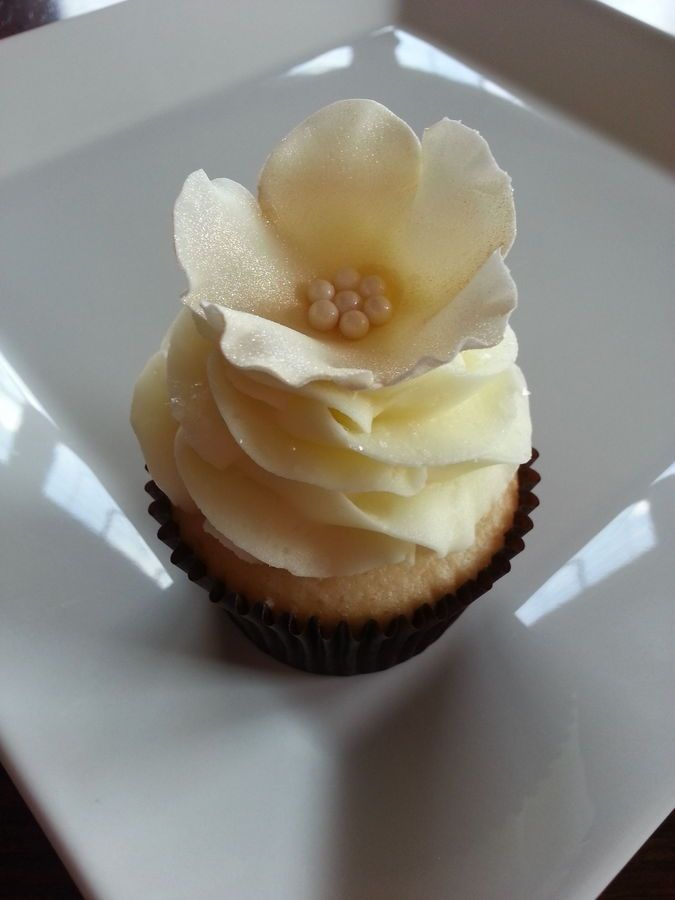 cupcake recipes for bridal shower%0A Light yellow vanilla buttercream and vanilla cake with gold dusted flowers  for a wedding