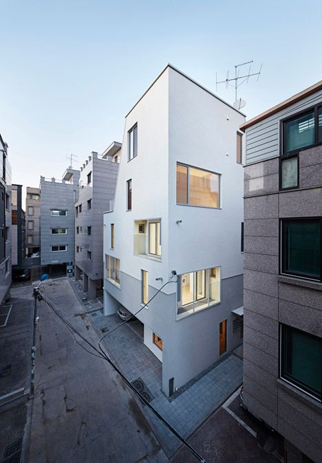 White Cone House creates daylit homes on a restricted Seoul site.