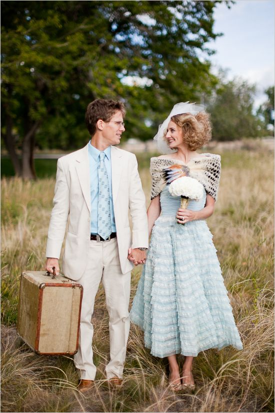 vintage blue wedding dress and love the groom's daring cream suit with matching shirt! I'll take the groom too!