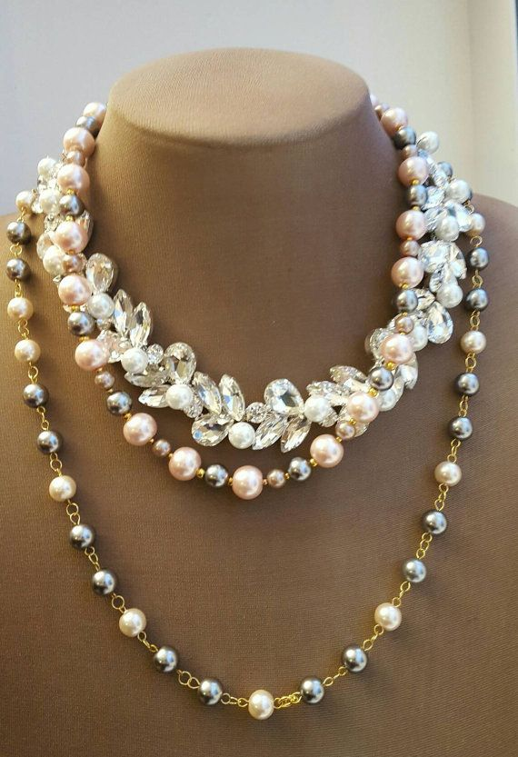 Check out this item in my Etsy shop https://www.etsy.com/ca/listing/488924274/multistrand-pink-and-grey-pearl