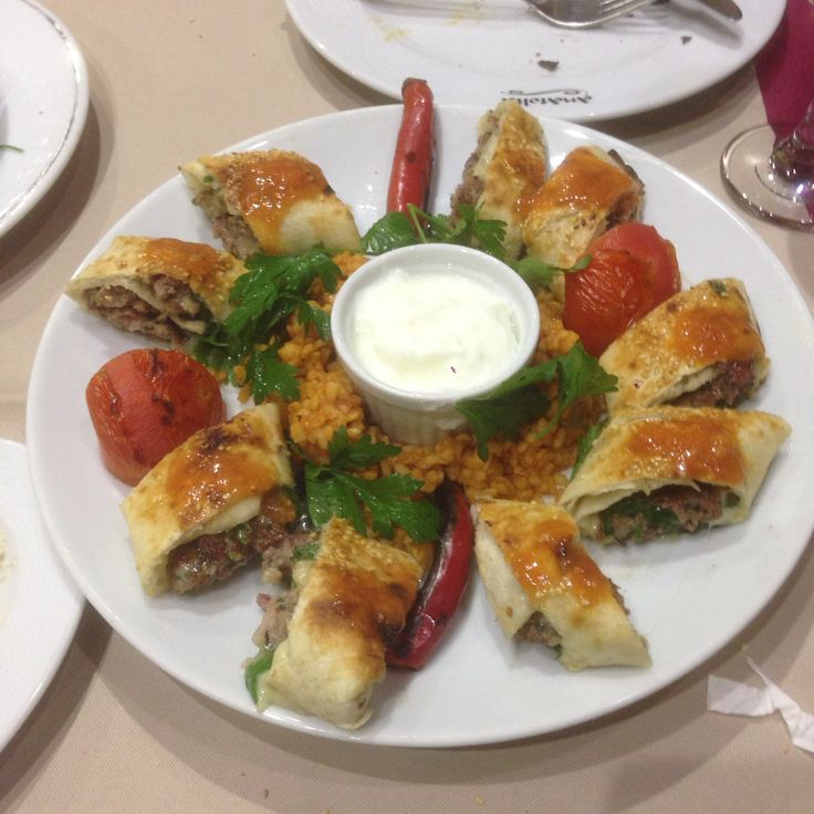 Beyti(Beyti kebab is made of lamb or beef, seasoned and grilled on a skewer, often served in ...) Anatolia Restaurant Bucharest