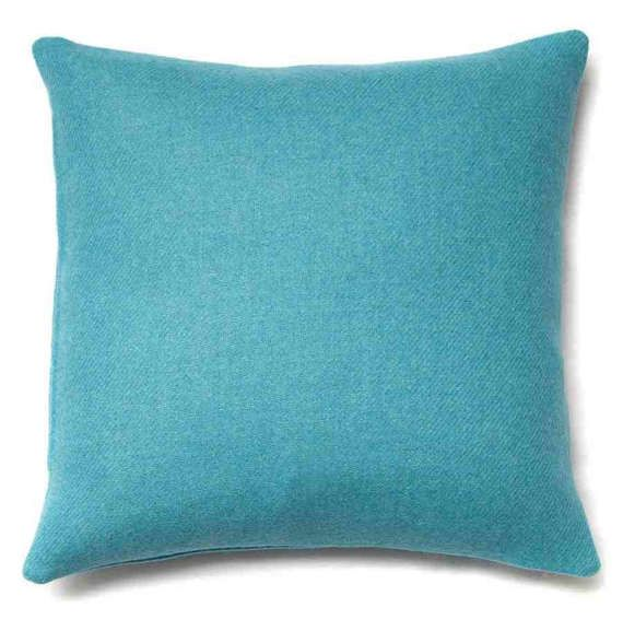 A vibrant bright teal blue Harris tweed cushion. Approximately 16 x 16 inch cushion filled with 18 x 18 inch duck feather cushion pad or 18 x 18 inch cushion filled with 20 x 20 inch duck feather cushion pad Concealed zip in base; dry clean only. Please note that actual size of cushion is smaller than cushion pad size to ensure that each cushion is well filled.