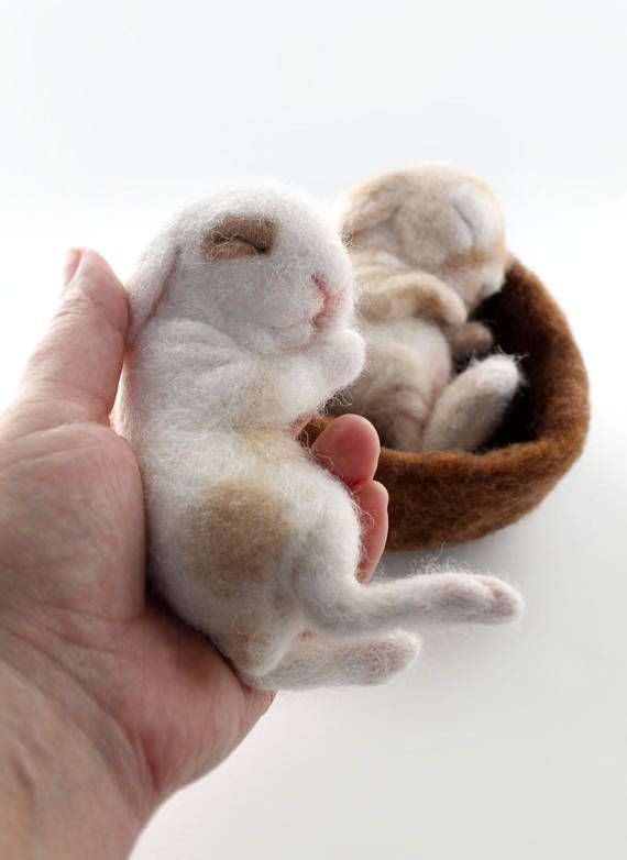 READY TO SHIP! Rabbits/ bunnies are animals that I just love to make! These two little babies sleep in a nest of of wool. The bunnies are each life size babies that fit in your hand. They are not attached to each other or the nest and can be taken out. But a warning, much handling