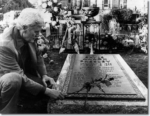 Above, Vernon Presley places a rose on his son's grave Nov. 24, 1977, as news people were permitted inside the grounds at Graceland in Memphis, Tenn., for the first time since Elvis' funeral.