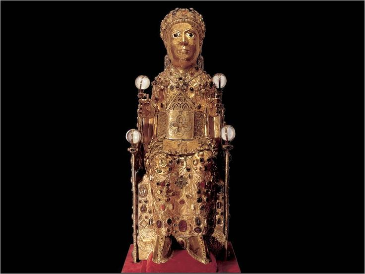 sainte-foy.jpg (1090×818)    Reliquary statue of Sainte-Foy (Saint Faith), late 10th to early 11th century with later additions.  Gold, silver gilt, jewels, and cameos over a wooden core, 2′ 9 1/2″ high.  Treasury, Sainte-Foy, Conques.