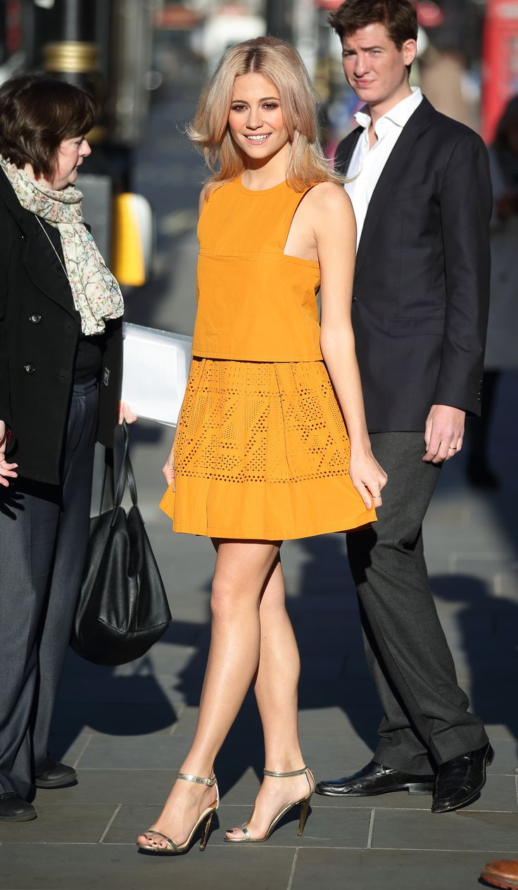 The charming Pixie Lott spotted in London wearing a Fendi Resort 2016 honey-colored dress.