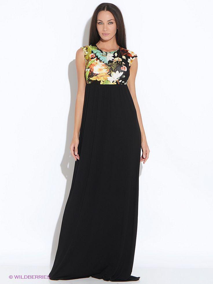 """Длинное трикотажное платье выполненное в контрастном цветовом сочетании. Под грудью - сборка. Сзади вырез в форме """"капли"""" и застежка на пуговицу."""