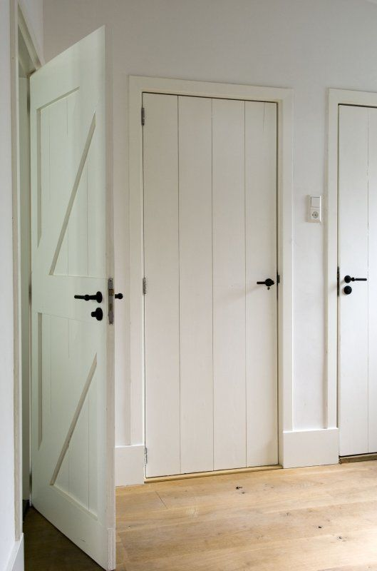 White brace & ledge doors with black door furniture