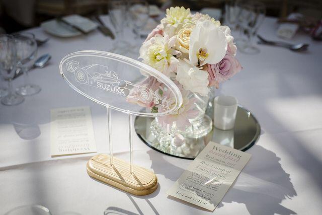 Guest table designs of phalanopsis orchid, hydrangea, dahlia, faith rose at Wrest Park,Silsoe flowers by www.wildorchidweddingflowers.co.uk